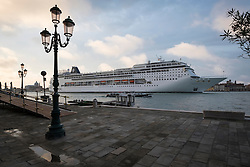 A cruise ship passes San Basilio along the Canale di Fusina in Venice, Italy.<br />