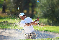BORRIOL, SPAIN - OCTOBER 19:  Rafael Nadal of Spain plays out of a bunker during the pro - am prior to the start of the Castello Masters Costa Azahar at the Club de Campo del Mediterraneo on October 19, 2011 in Borriol, Spain.  (Photo by Manuel Queimadelos Alonso/Getty Images)