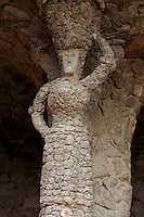 A stone sculpture of a woman within the grounds of Park Guell in Barcelona, Spain