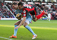 Picture by Tom Smith/Focus Images Ltd 07545141164<br /> 26/12/2013<br /> Elliot Ward (right) of Bournemouth runs into Marek Štēch (left) of Yeovil Town during the Sky Bet Championship match at the Goldsands Stadium, Bournemouth.