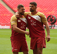 Remi Casty (L) Captain of Catalan Dragons shares a hug with team mate Mickael Simon (R) during the Catalan Dragons Captains Run ahead of the Ladbrokes Challenge Cup Final at Wembley Stadium, London<br /> Picture by Stephen Gaunt/Focus Images Ltd +447904 833202<br /> 24/08/2018
