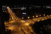 CHENGGONG, CHINA -China Out - Finland Out<br /> <br /> Ghost City <br /> <br /> Several vehicles make their way along an illuminated street on November 22, 2013 in Chenggong, Yunnan Province of China. Chenggong is a satellite city located just south of Kunming. As of 2012, much of the newly constructed housing in Chenggong is still unoccupied, and it is reportedly one of the largest ghost towns in Asia. According to a China Youth Daily report in July, at least 12 such ghost cities across the country have been found. Besides the best known of these - Ordos in North China's Inner Mongolia Autonomous Region, the list also included Changzhou in Jiangsu, Zhengdong New Area in Henan Province, Shiyan in Hubei and Chenggong District of Kunming in Yunnan.<br /> ©Exclusivepix