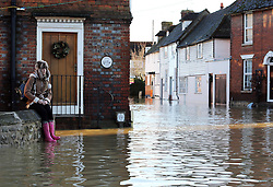 Boxing Day floods.. A resident in Yalding, Kent  surveys the scene as the villagers  brace themselves for the possibility of  more flooding with another storm on the way, Thursday, 26th December 2013. Picture by Stephen Lock / i-Images