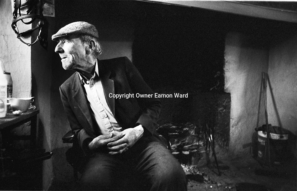Martin Quinn, Milltown Malbay ,Co Clare by the open hearth  in his traditional cottage.....Photograph by Eamon Ward Freelance /The Clare People....(Highest Quality Digital File will be available if Chosen for Book)....
