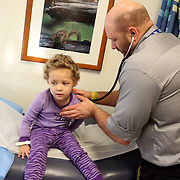 On December 27, 2012 two year old Holly Larue Frizzelle was diagnosed with Acute Lymphoblastic Leukemia. What began as a stomach ache and visit to her regular pediatrician led to a hospital admission, transport to the University of North Carolina Children's Hospital, and more than two years of treatment. Holly Larue Frizzelle, 3, is examined by Dr. Troutman at the Pediatric Hematology Oncology Clinic at the University of North Carolina Hospital on December 27, 2013, exactly one year after her diagnosis. Dr. Troutman is the doctor who took the phone call that resulted in Larue being transported to UNC.
