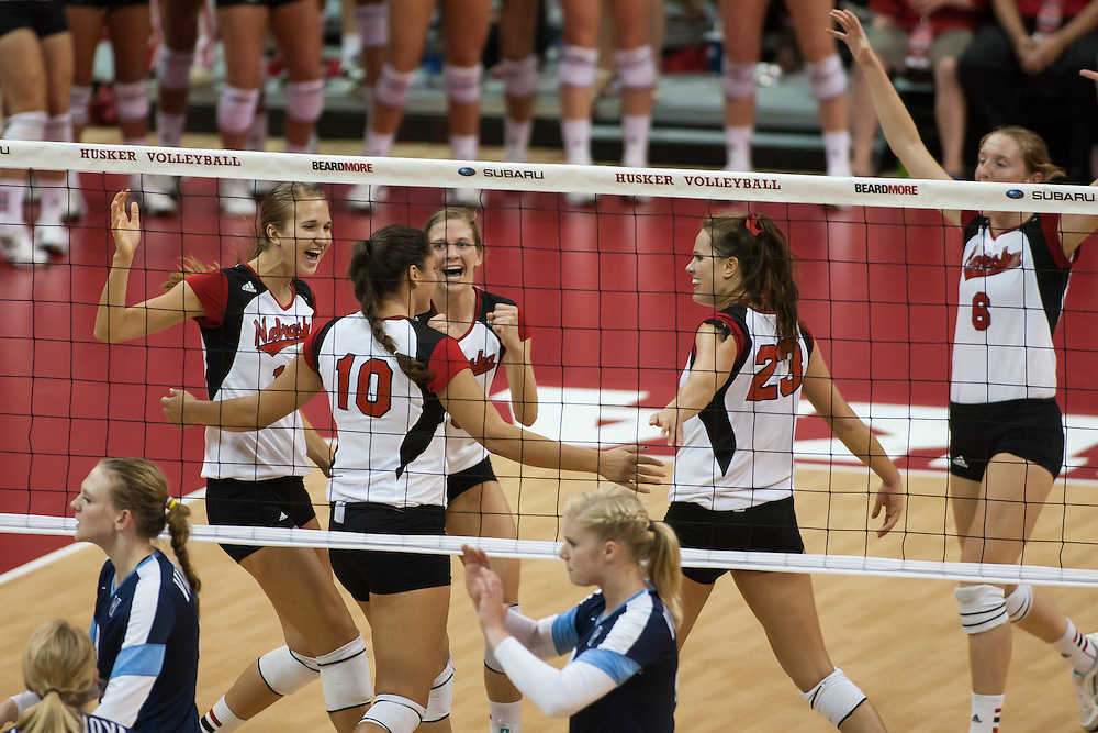 September 6, 2013: Huskers celebrate a score by Alicia Ostrander #9 from a block against Villanova Wildcats at the Devaney Sports Center in Lincoln, Nebraska. Nebraska defeated Villanova three sets to one.