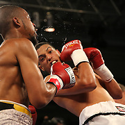 Moises Carasquillo (R) punches  Marqus Jackson during a Telemundo boxing match at the Kissimmee Civic Center on Friday, July 17, 2015 in Kissimmee, Florida.  (AP Photo/Alex Menendez)