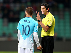 Referee Deniz Aytekin of Germany gives Valter Birsa of Slovenia the V sign to indicate he has made two fouls - Mandatory by-line: Robbie Stephenson/JMP - 11/10/2016 - FOOTBALL - RSC Stozice - Ljubljana, England - Slovenia v England - World Cup European Qualifier