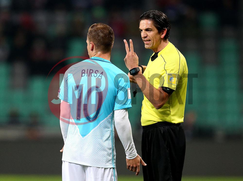 Referee Deniz Aytekin of Germany gives Valter Birsa of Slovenia the V sign to indicate he has made two fouls - Mandatory by-line: Robbie Stephenson/JMP - 11/10/2016 - FOOTBALL - RSC Stozice - Ljubljana, England - Slovenia v England - World Cup European Qualifier
