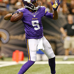 Sep 21, 2014; New Orleans, LA, USA; Minnesota Vikings quarterback Teddy Bridgewater (5) throws a pass against the Minnesota Vikings during the second half of a game at Mercedes-Benz Superdome. The Saints defeated the Vikings 20-9. Mandatory Credit: Derick E. Hingle-USA TODAY Sports