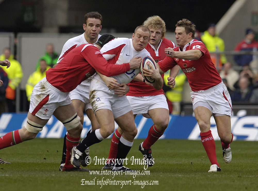 Mike Tindell, is surrounded by Welsh defenders left, Ian Gough, Duncan Jones and right Matthew Watkins, Joe Worlsey lend's support, in the 2006 RBS Six Nations Match, England vs Wales, Twickenham on the 04.02.2006.   © Peter Spurrier/Intersport Images - email images@intersport-images mob +44[0]7973 819 551..   [Mandatory Credit, Peter Spurier/ Intersport Images].