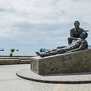 The statue and church of Motael, right in front of the sea, dedicated to the people who died at Dili cemetery, killed by the Indonesian army, while celebrating the funeral of Sebastião Gomes, an independence supporter