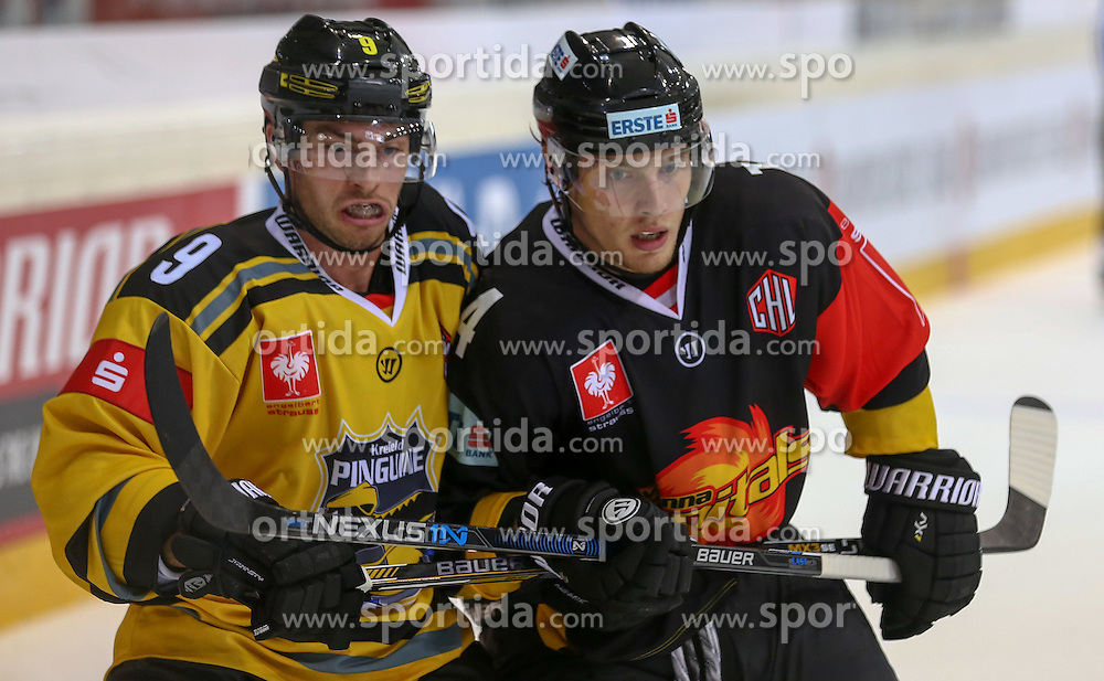 29.08.2015, Albert Schultz Eishalle, Wien, AUT, CHL, UPC Vienna Capitals vs Krefeld Pinguine, im Bild Hunter Bishop (Krefeld Pinguinie) und Patrick Peter (Vienna Capitals) // during the Champions Hockey League match between UPC Vienna Capitals and Krefeld Pinguine at the Albert Schultz Ice Arena, Vienna, Austria on 2015/08/29. EXPA Pictures © 2015, PhotoCredit: EXPA/ Alexander Forst
