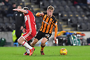 Middlesbrough FC midfielder Grant Leadbitter (7)  and Hull City forward Jarrod Bowen (20)  during the EFL Sky Bet Championship match between Hull City and Middlesbrough at the KCOM Stadium, Kingston upon Hull, England on 31 October 2017. Photo by Ian Lyall.