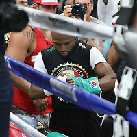 LAS VEGAS, NV - APRIL 14: WBC/WBA welterweight champion Floyd Mayweather Jr. puts on his gloves before he works out at the Mayweather Boxing Club on April 14, 2015 in Las Vegas, Nevada. Mayweather will face WBO welterweight champion Manny Pacquiao in a unification bout on May 2, 2015 in Las Vegas.  (Photo by Alex Menendez/Getty Images) *** Local Caption *** Floyd Mayweather Jr.