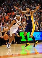 Oct. 29 2010; Phoenix, AZ, USA; Phoenix Suns guard-forward Jared Dudley (3) drives the ball against Los Angeles Lakers guard-forward Matt Barnes (9) during the second quarter at the US Airways Center. Mandatory Credit: Jennifer Stewart-US PRESSWIRE.