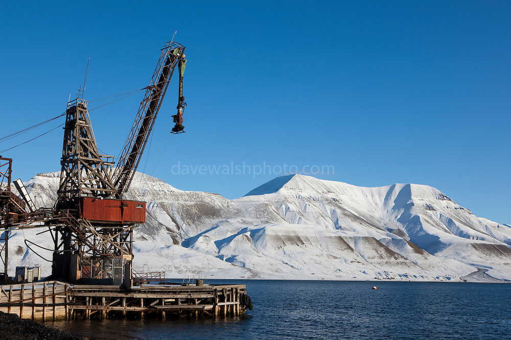 Coal mining machinery, port of Longyearbyen, Svalbard. Coal mining was the basis for the creation of Longyearbyen, 1300km from the North Pole. Now the remains are left as historic reminders of the past, while coal mines elsewhere in Spitsbergen are now the main focus.