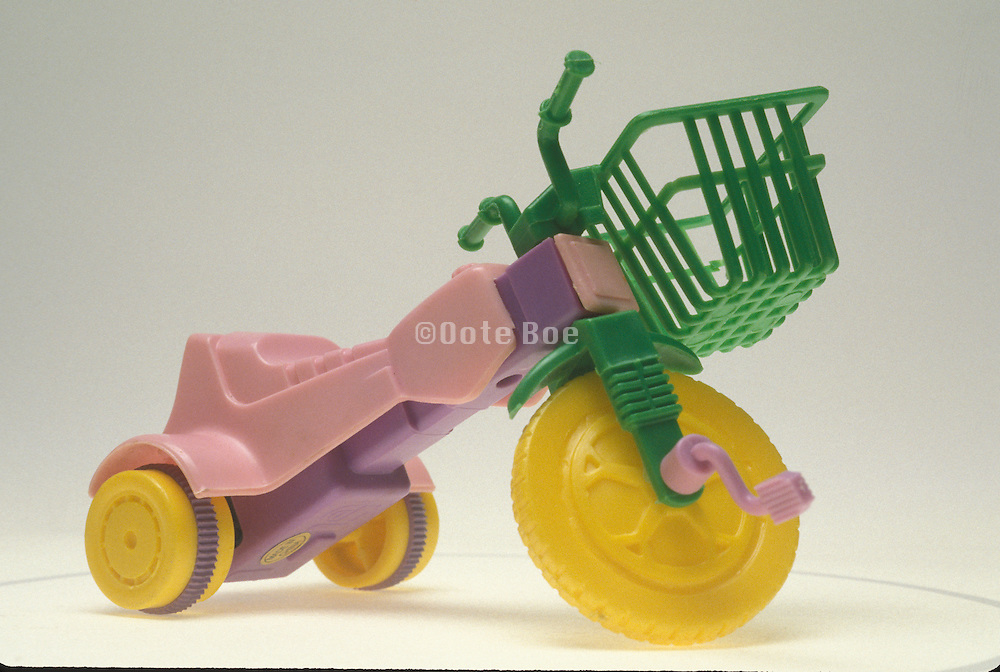 toy scooter with green basket