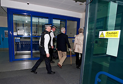 © Licensed to London News Pictures. 24/02/2012. Heathrow, UK. Christopher Tappin and his wife Elaine entering Heathrow Police station before Christopher Tappin surrendered himself for extradition to the the USA. Christopher Tappin is charged with conspiring to export defence articles without licence or approval in relation to the sale of batteries that were allegedly used in Iranian surface-to-air missiles. Photo credit : Ben Cawthra/LNP