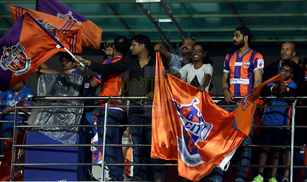 FC Pune City fan's enjoy during match 8 of the Indian Super League (ISL) season 3 between FC Goa and FC Pune City held at the Fatorda Stadium in Goa, India on the 8th October 2016.<br /> <br /> Photo by Sandeep Shetty / ISL/ SPORTZPICS