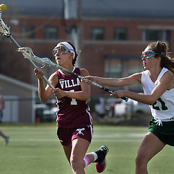 Villa Duchesne's Louise Keefer (1) and Nerinx Hall's Kelly Gallagher (21) battled for the ball in the first half of a game between Nerinx Hall High School and Villa Duchesne at Nerinx Hall in Webster Groves April 5, 2016. Villa Duchesne won 9-8. Teak Phillips | St. Louis Review