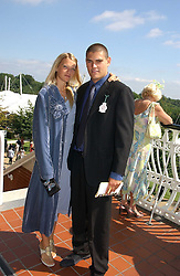 LADY ALEXANDRA GORDON-LENNOX and JULIAN DRAPER at the 3rd day of the Glorious Goodrwood Racing festival 2006 - Ladies Day, at Goodwood Race course, West Sussex on 3rd August 2006.<br />