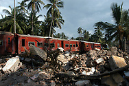 The passenger train that the December 26, 2004 tsunami derailed killing hundreds of people and destroying the village. Seenigama, Sri Lanka. 19/01/2005. Photo © J.B. Russell