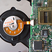 Close-up of computer circuit board on an internal hard disk drive.
