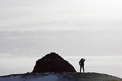 ***CAPTION CORRECTION***© Licensed to London News Pictures. 14/01/2015. Wheddon Cross, Somerset, UK. A man stops to take in the view from Dunkery Beacon in Exmoor National Park, Somerset this morning, 14th January 2015. Snow has fallen overnight across many parts of England, causing travel disruption in some areas.  Photo credit : Rob Arnold/LNP