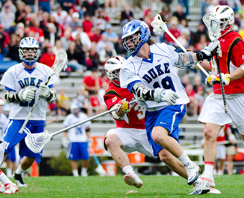 March 5 2011:Duke attack Christian Walsh (19) drives up field.