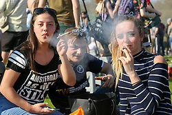© Licensed to London News Pictures. 20/04/2019. London, UK. Thousands of revellers gather to smoke cannabis in London's Hyde Park without been detained as part of '4/20 Day', an unofficial International Weed Day, an event that takes place every year on 20 April. Attendees are calling on the Government to decriminalise Class B drug and raise awareness about the drug. Photo credit: Dinendra Haria/LNP