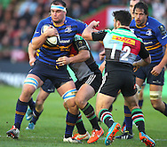 George Lowe ( 2nd R ) of Harlequins challenges Dominic Ryan ( L ) of Leinster during the European Rugby Champions Cup match at Twickenham Stoop , London<br /> Picture by Paul Terry/Focus Images Ltd +44 7545 642257<br /> 07/12/2014