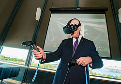 Pictured: Education Secretary John Swinney MSP tries out one of the new interactive 3D games.<br /> <br /> &copy; Dave Johnston / EEm