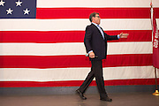 Former Texas Governor and GOP presidential hopeful Rick Perry walks off stage after addressing a crowd of supporters during a town hall campaign event aboard the USS Yorktown June 8, 2015 in Mount Pleasant, South Carolina.