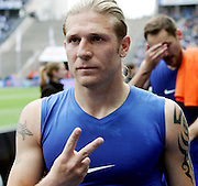 Hertha Berlin's Andrei Voronin shows his appreciation to the photographer after the Bundesliga match between Hertha BSC v Schalke 04, 16th May 2009.<br /> <br /> UK ONLY