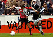 Photo: Gerrit de Heus. Rotterdam. 11/04/04..Feyenoord-Ajax. Ebi Smolarek (L) in duel met Nigel de Jong.