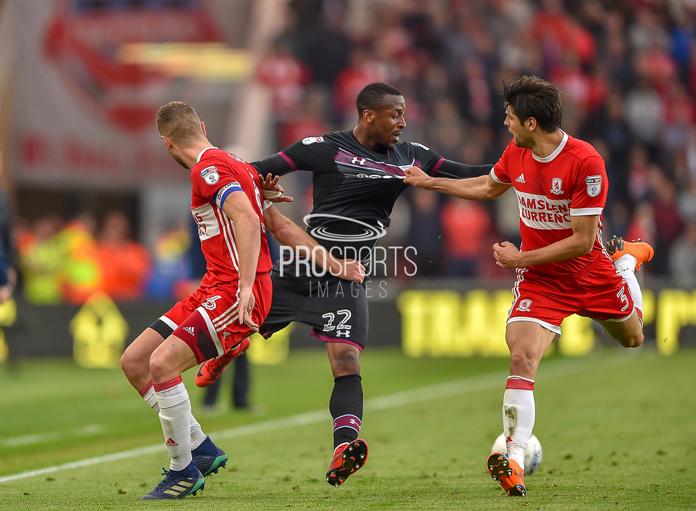 Aston Villa striker Jonathan Kodija (22) jostles with Middlesbrough defender George Friend (3) and Middlesbrough defender Ben Gibson (6) during the EFL Sky Bet Championship match between Middlesbrough and Aston Villa at the Riverside Stadium, Middlesbrough, England on 12 May 2018. Picture by Jon Hobley.