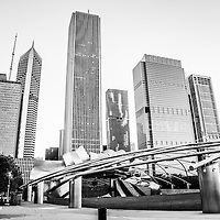 Jay Pritzker Pavilion with Chicago skyline high resolution black and white photo. Scene includes Grant Park, Millenium Park, Aon Center Building, Prudential Plaza, Prudential Tower, Aqua Building, and Blue Cross Blue Shield building.