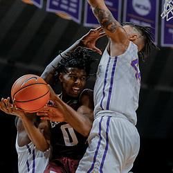 Jan 23, 2018; Baton Rouge, LA, USA; Texas A&M Aggies guard Jay Jay Chandler (0) is defended by LSU Tigers forward Wayde Sims (44) and forward Duop Reath (left) during the first half at the Pete Maravich Assembly Center. Mandatory Credit: Derick E. Hingle-USA TODAY Sports