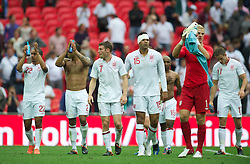 LONDON, ENGLAND - Saturday, June 2, 2012: England's Theo Walcott, Glen Johnson, James Milner, Joleon Lescott and goalkeeper Joe Hart applaud the supporters after the 1-0 victory over Belgium during the International Friendly match at Wembley. (Pic by David Rawcliffe/Propaganda)