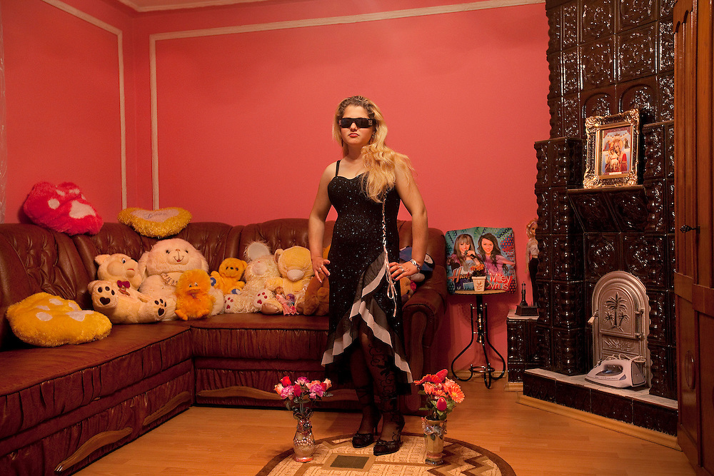 Beny Iancu, 16, stands in her fiancé's bedroom in Buzescu, a small town in Romania.
