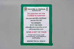 Edinburgh, Scotland, UK. 24 March, 2020.  Sign on famous grocer Valvona & Crolla on Leith Walk, stating it is closed but still trading online. All shops and restaurants are closed with very few people venturing outside following the Government imposed lockdown today. Iain Masterton/Alamy Live News