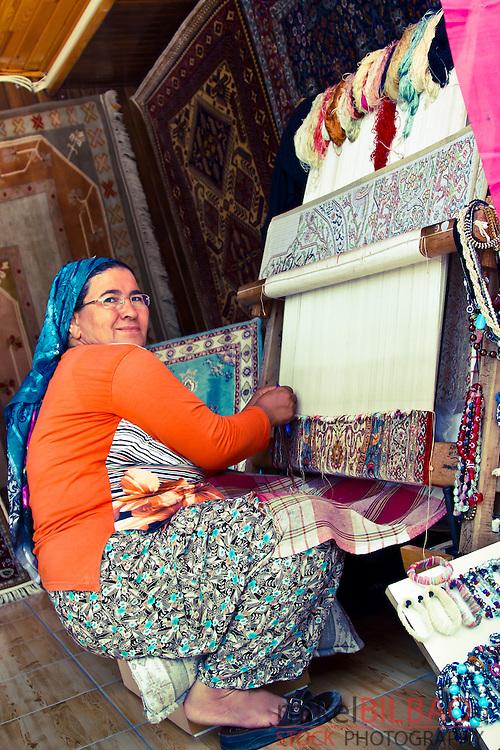 Woman making a carpet. Side. Province of Antalya. Mediterranean coast. Turkey