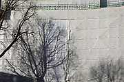 Construction sheeting and the shadows of trees with new housing at Elephant Park, on 30th January 2018, in the south London borough of Southwark, England.