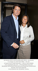 DR MARK CECIL and his wife KATE CECIL  at a party in London on 23rd April 2003.			PIY 141