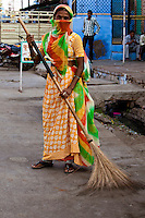 Portrait of an Indian woman sweeping the streets. Indian culture photography prints for sale. exotic people and places, fine art photography and wall art, stock images.