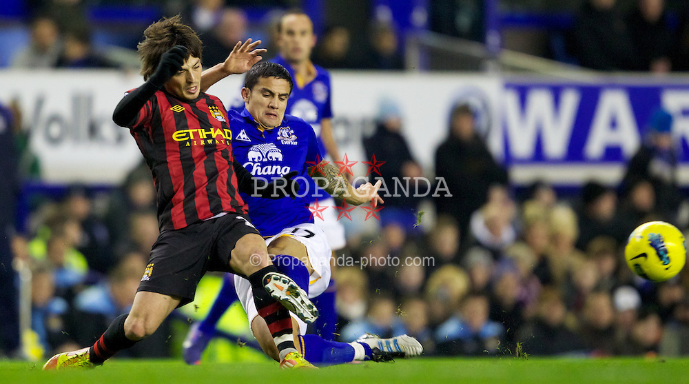 LIVERPOOL, ENGLAND - Tuesday, January 31, 2012: Manchester City's David Silva in action against Everton's Tim Cahill during the Premiership match at Goodison Park. (Pic by Vegard Grott/Propaganda)