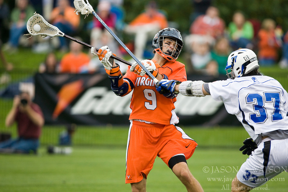Virginia attackman Danny Glading (9) shoots over Duke defenseman Mike Manley (37).  The #2 ranked Duke Blue Devils defeated the #3 ranked Virginia Cavaliers 11-9 in the finals of the Men's 2008 Atlantic Coast Conference tournament at the University of Virginia's Klockner Stadium in Charlottesville, VA on April 27, 2008.