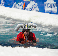 Ken McDonald was glad he brought a little extra plumbing along during his attempt to cross the pond  during Gunstock's annual B.Y.O.D.C. Pond Skim on Sunday afternoon.  (Karen Bobotas/for the Laconia Daily Sun)