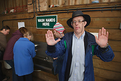 Man with learning disability on trip to farm showing he has washed his hands